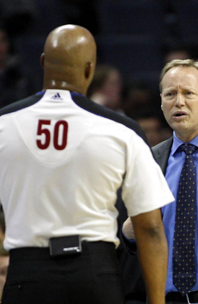 Atlanta Hawks coach Mike Budenholzer talks with official Olandis Poole as the Hawks play the Charlotte Bobcats in the second half of an NBA basketball game in Charlotte, N.C., Monday, Nov. 11, 2013. Atlanta won 103-94