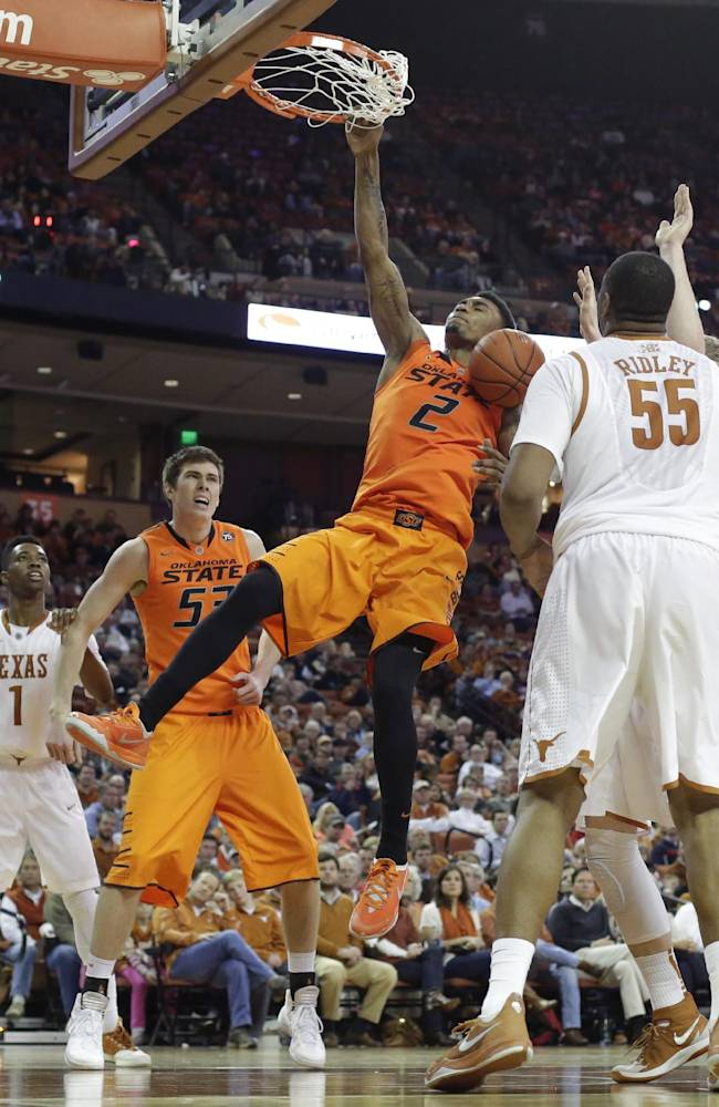 Oklahoma State's Le'Bryan Nash (2) scores against Texas during the second half on an NCAA college basketball game, Tuesday, Feb. 11, 2014, in Austin, Texas. Texas won 87-68