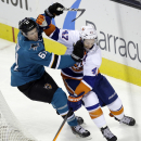 New York Islanders' Andrew MacDonald (47) collides with San Jose Sharks' Justin Braun (61) during the second period of an NHL hockey game on Tuesday, Dec. 10, 2013, in San Jose, Calif The Associated Press