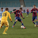 CSKA's Mario Fernandes, centre, in action during the Champions League Group E soccer match between CSKA Moscow and Manchester City at Arena Khimki stadium in Moscow, Russia, Tuesday Oct. 21, 2014