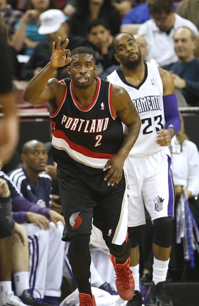 Portland Trail Blazers Wesley Matthews, left, flashes three fingers after scoring a three point shot against Sacramento Kings guard Marcus Thornton, right, during the third quarter of an NBA basketball game in Sacramento, Calif., Saturday, Nov. 9, 2013.  The Trail Blazers won 96-85