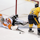 Philadelphia Flyers goalie Steve Mason (35) blocks a shot by Nashville Predators forward Matt Hendricks (26) during a shootout at an NHL hockey game Saturday, Nov. 30, 2013, in Nashville, Tenn. The Flyers won the shootout to win the game 3-2 The Associate