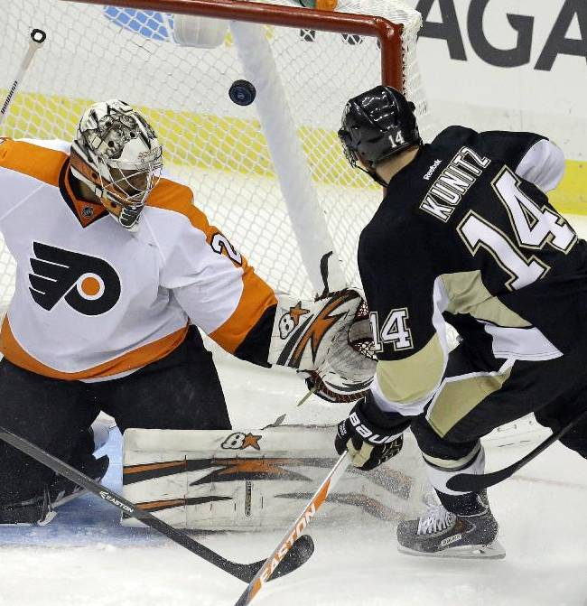Pittsburgh Penguins' Chris Kunitz (14) puts the puck behind Philadelphia Flyers goalie Ray Emery (29) in the first period of an NHL hockey game in Pittsburgh, Wednesday, Nov. 13, 2013. The goal was disallowed because the puck went in off Kunitz's skate