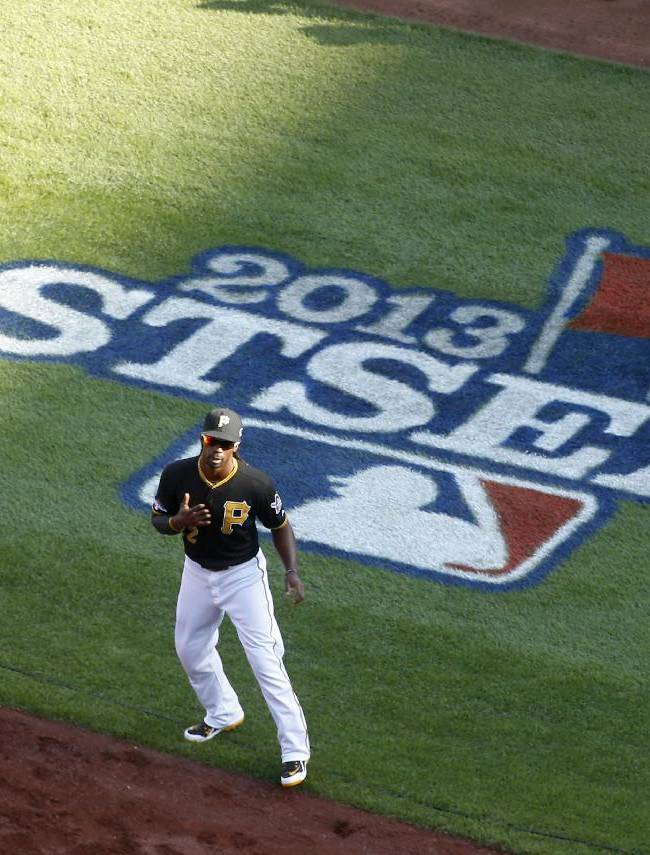 Pittsburgh Pirates' Andrew McCutchen takes the field during the introductions before game 3 of a National League baseball division series against the St. Louis Cardinals on Sunday, Oct. 6, 2013, in Pittsburgh