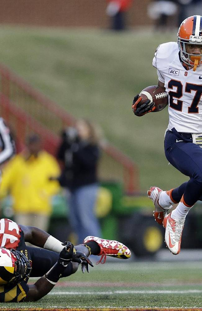 Syracuse running back George Morris II (27) leaps past Maryland linebacker Yannick Ngakoue as he rushes the ball in the first half of an NCAA college football game in College Park, Md., Saturday, Nov. 9, 2013
