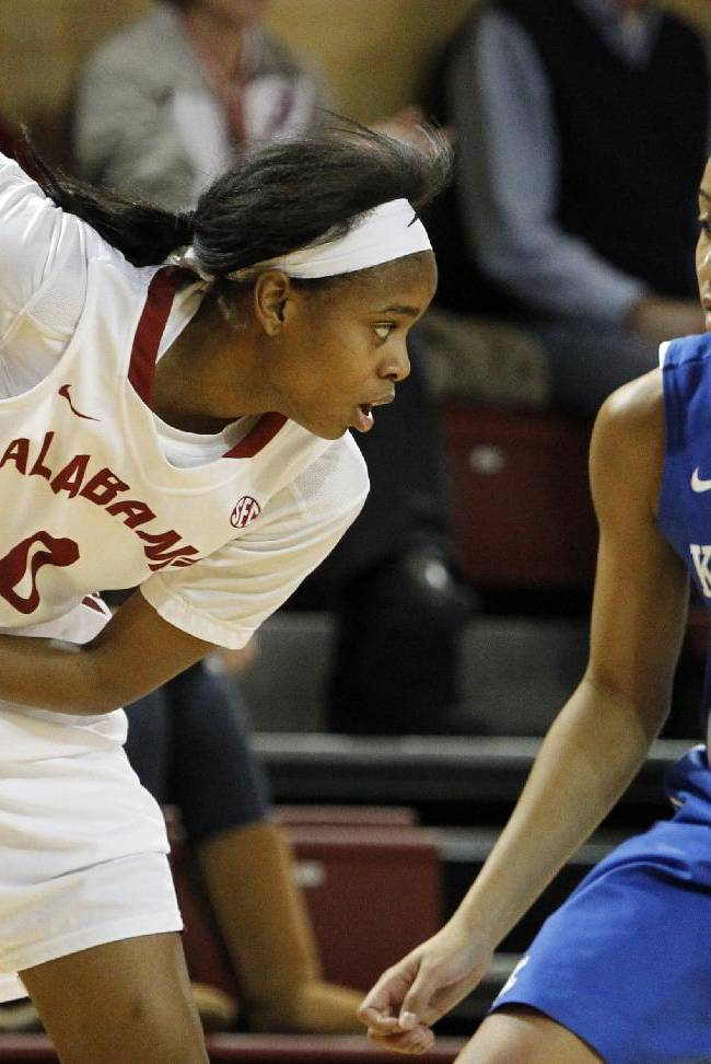 Alabama's Daisha Simmons (0) pulls in a rebound away from Kentucky's Kastine Evans (32) during the second half of an NCAA college basketball game on Thursday, Jan. 2, 2014, in Tuscaloosa, Ala