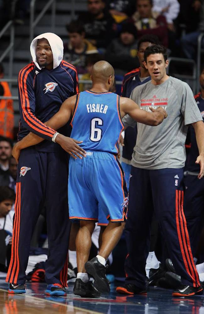 The NBA team Oklahoma City Thunder's Kevin Durant, left, Derek Fisher and Steven Adams during a preseason basketball game with Fenerbahce Ulker in Istanbul, Turkey, Saturday, Oct. 5, 2013. Oklahoma City Thunder has opened the preseason schedule with a game against the five-time Turkish champions at the Ulker Sports Arena.(AP Photo)