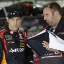 Matt Kenseth, left, talks with crew chief Matthew Lucas, right, during practice for Saturday's NASCAR Nationwide series History 300 auto race at Charlotte Motor Speedway in Concord, N.C., Thursday, May 23, 2013. (AP Photo/Nell Redmond)