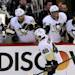 Pittsburgh Penguins Tyler Kennedy (48) celebrates his goal with teammates during the second period of game four of the Eastern Conference Stanley Cup semi-final NHL hockey action on Sunday May 19, 2013 in Ottawa.  (AP Photo/The Canadian Press, Fred Chartrand)