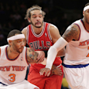 New York Knicks forward Kenyon Martin (3) and New York Knicks forward Carmelo Anthony (7) defend Chicago Bulls center Joakim Noah (13) on a rebound in the second half of their NBA basketball game at Madison Square Garden in New York, Wednesday, Dec. 11, 2