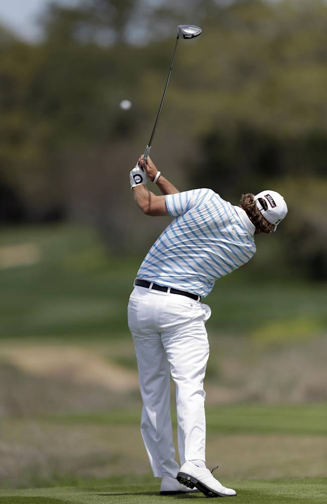 Andrew Loupe hits his tee shot on the eighth hole during the third round of the Texas Open golf tournament, Saturday, March 29, 2014, in San Antonio