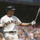 Maxwell keeps family together, adds big bat, glove in right The Associated Press