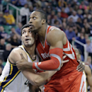 Utah Jazz's Enes Kanter, left, defends against Houston Rockets' Dwight Howard, right, in the fourth quarter of an NBA basketball game Monday, Dec. 2, 2013, in Salt Lake City. The Jazz won 109-103 The Associated Press