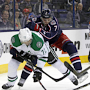 Dallas Stars' Erik Cole, left, works for the puck against Columbus Blue Jackets' Jack Johnson in the first period of an NHL hockey game in Columbus, Ohio, Tuesday, March 4, 2014 The Associated Press