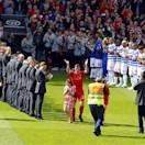 Liverpool and Queens Park Rangers players perform a guard of honour for Jamie Carragher prior to the the English Premier League soccer match at Anfield, Liverpool, England, Sunday May 19, 2013. Jamie Carragher is to play his final match before retiring. (AP Photo/PA, Peter Byrne)
