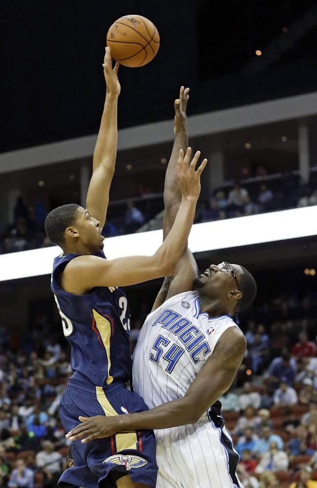 New Orleans Pelicans' Anthony Davis, left, shoots over Orlando Magic's Jason Maxiell (54) during the first half of an NBA preseason basketball game in Jacksonville, Fla., Wednesday, Oct. 9, 2013