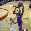 Detroit Pistons power forward Greg Monroe (10) goes to the basket over New Orleans Pelicans power forward Ryan Anderson (33) in the first half of an NBA basketball game in New Orleans, Wednesday, Dec. 11, 2013. (AP Photo/Gerald Herbert)