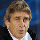 FILE - In this Feb. 18, 2013 file photo, Malaga's coach Manuel Pellegrini, from Chile, attends a news conference before a soccer training session at FC Porto's Dragao stadium in Porto, Portugal. Manchester City has hired Manuel Pellegrini as the club's new manager to replace the fired Roberto Mancini. Pellegrini has signed a three-year contract and will begin his job on June 24, 2013. (AP Photo/Paulo Duarte, File)