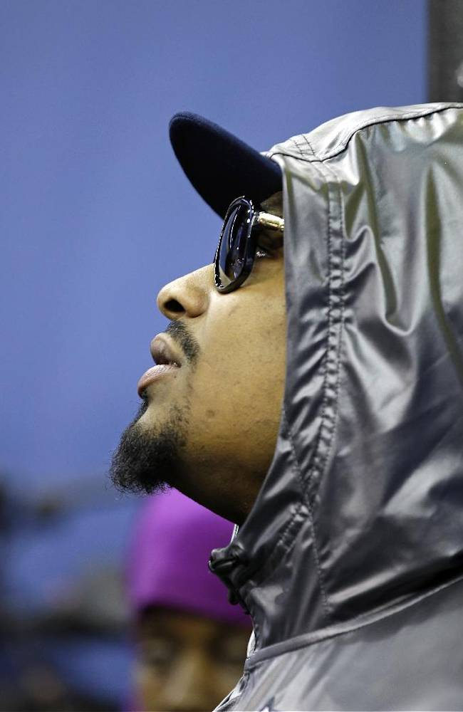 Seattle Seahawks' Marshawn Lynch stands against a wall during media day for the NFL Super Bowl XLVIII football game Tuesday, Jan. 28, 2014, in Newark, N.J