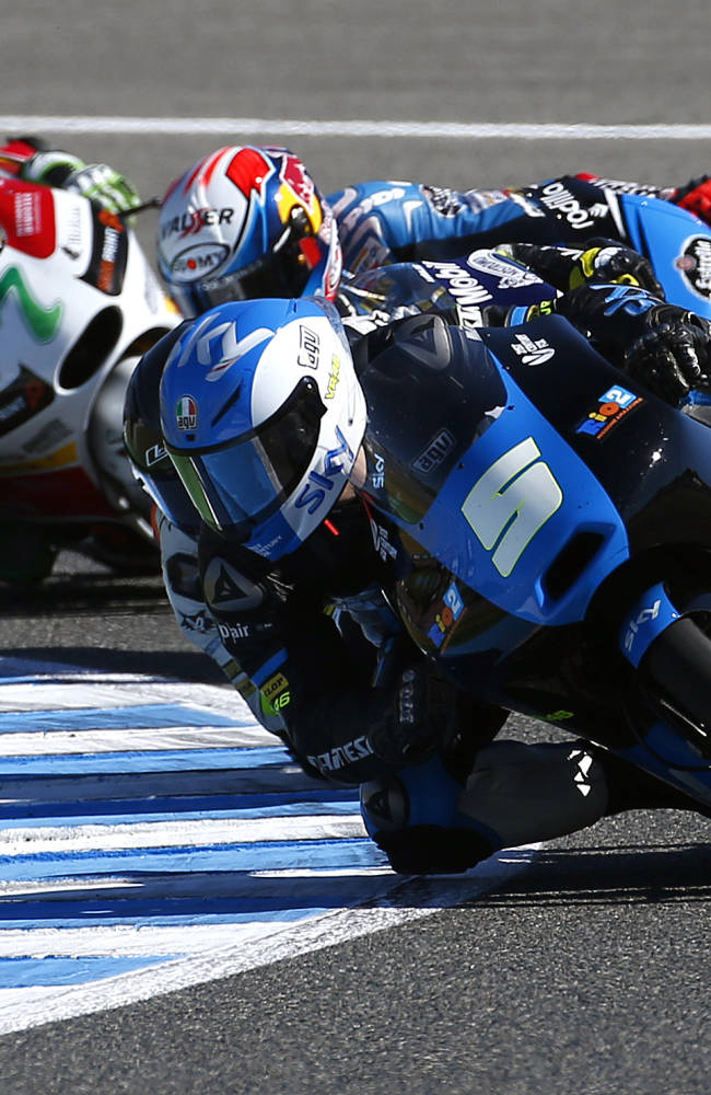 Moto 3 rider Romano Fenati of Italy steers his motorcycle followed by Alex Rins and Efren Vazquez, both from Spain, during the Spain's Motorcycle Grand Prix at the Jerez race track on Sunday, May 4, 2014 in Jerez de la Frontera, southern Spain
