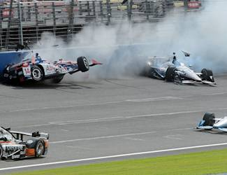Takuma Sato (14) goes airborne after colliding with Will Power, top right, during the closing laps Saturday June 27, 2015 during the IndyCar auto race at Auto Club Speedway in Fontana, Calif. (AP Photo/Will Lester)