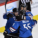 Colorado Avalanche center Matt Duchene (9) is congratulated by teammates Patrick Bordeleau (58) and Cody McLeod (55) after scoring a goal against the Vancouver Canucks during the first period of an NHL hockey game on Thursday, March 27, 2014, in Denver Th