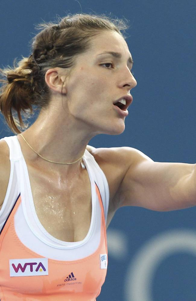 Andrea Petkovic of Germany reacts to an umpire's call in her 2nd round match against Serena Williams of the USA during the Brisbane International tennis tournament in Brisbane, Australia, Tuesday, Dec. 31, 2013