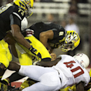 Oregon quarterback Marcus Mariota (8) goes down in the end zone when sacked by Washington State defensive tackle Xavier Cooper, obscured, and linebacker Kache Palacio (40) as right tackle Tyrell Crosby (73) tries to help his quarterback during the second quarter of an NCAA college football game Saturday, Sept. 20, 2014, at Martin Stadium in Pullman, Wash. The ball was placed on the 1-yard line based on Mariota's forward progress. (AP Photo/Dean Hare)