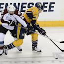 Colorado Avalanche center Maxime Talbot (25) and Nashville Predators forward Colin Wilson (33) battle for the puck in the third period of an NHL hockey game on Tuesday, March 25, 2014, in Nashville, Tenn. The Avalanche won in a shootout 5-4 The Associated
