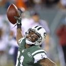 New York Jets wide receiver Jeremy Kerley (11) celebrates after scoring a touchdown against the Chicago Bears in the second quarter of an NFL football game, Monday, Sept. 22, 2014, in East Rutherford, N.J. (AP Photo/Bill Kostroun)