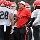 Georgia defensive coordinator Todd Grantham, center, talks with players during spring NCAA college football practice in Athens, Ga., Saturday, March 2, 2013. (AP Photo/The Banner-Herald, AJ Reynolds)