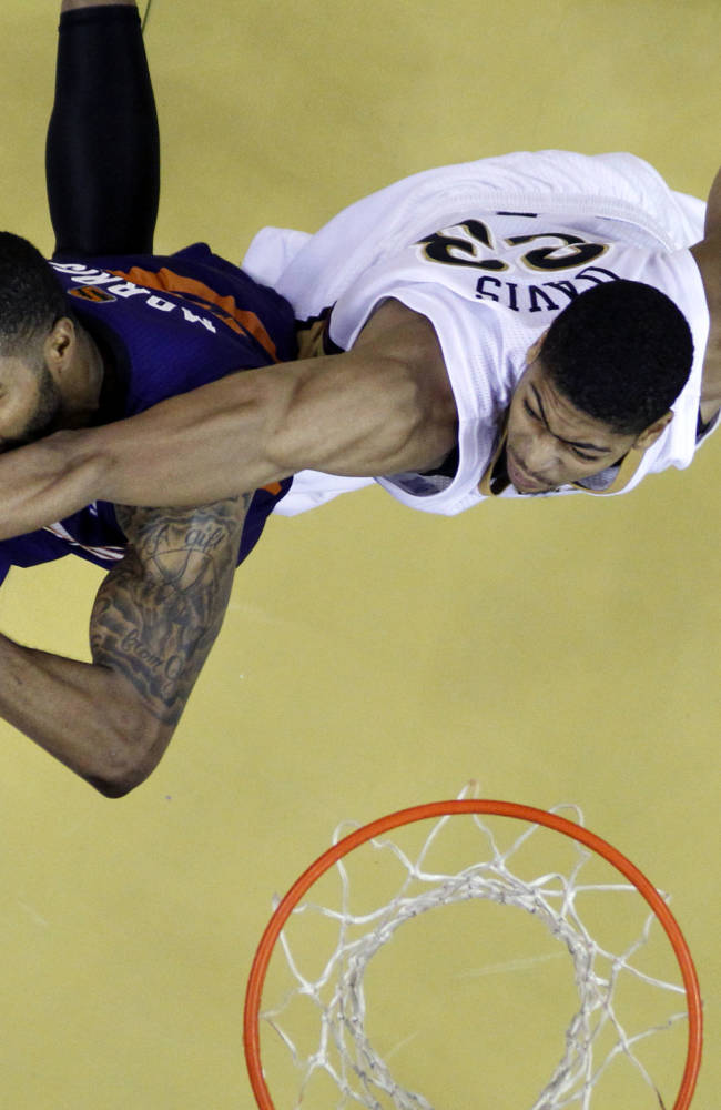Phoenix Suns power forward Markieff Morris, left, battles against New Orleans Pelicans power forward Anthony Davis (23) in the second half of an NBA basketball game in New Orleans, Tuesday, Nov. 5, 2013. The Suns won 104-98