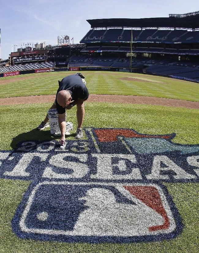 Atlanta Braves field director Ed Mangan prepares a logo at Turner Field before Thursday's Game 1 of the National League Division Series between the Los Angeles Dodgers and the Braves, Wednesday, Oct. 2, 2013, in Atlanta