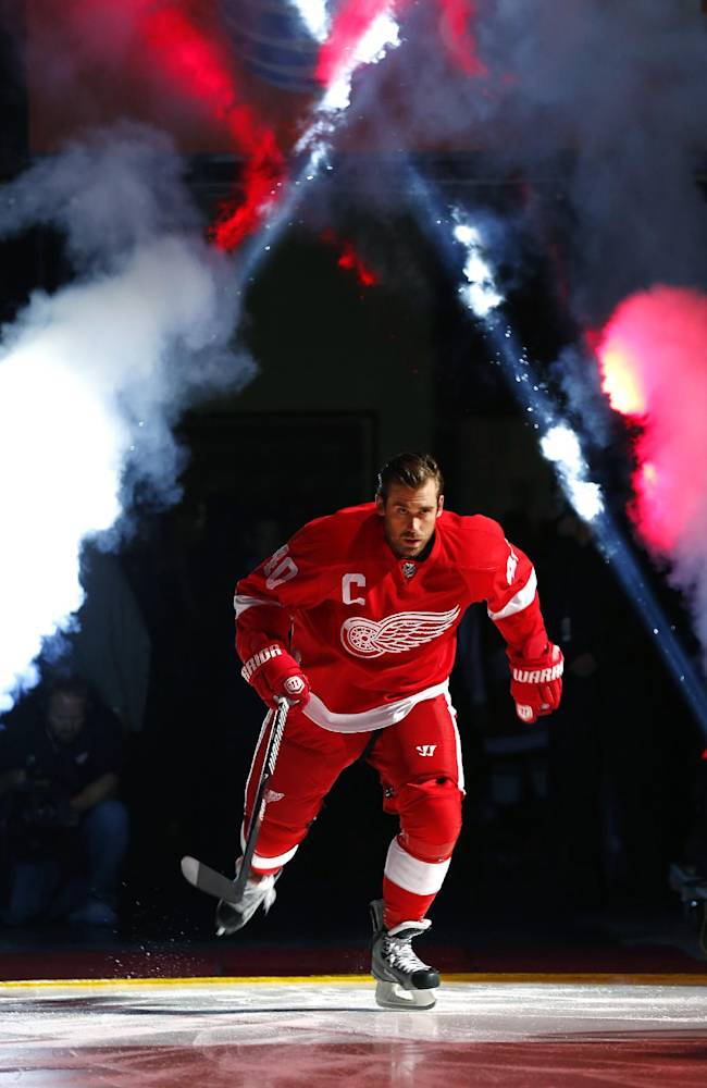Detroit Red Wings' Henrik Zetterberg is introduced before an NHL hockey game against the Buffalo Sabres on Wednesday, Oct. 2, 2013, in Detroit