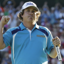 Jason Dufner celebrates winning the PGA Championship golf tournament at Oak Hill Country Club, Sunday, Aug. 11, 2013, in Pittsford, N.Y. (AP Photo/Charlie Neibergall)