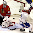 Chicago Blackhawks goalie Corey Crawford (50), left, reacts after Montreal Canadiens' Dale Weise (22) scored a goal during the third period of an NHL hockey game in Chicago, Wednesday, April 9, 2014. The Blackhawks won 3-2 in overtime The Associated Press