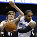 Orlando Magic's Jameer Nelson, right, looks to pass the ball as his path to the basket is blocked by Brooklyn Nets' Andrei Kirilenko, left, during the second half of an NBA basketball game in Orlando, Fla., Wednesday, April 9, 2014. Orlando won 115-111 Th