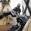Detroit Tigers Victor Martinez grabs his catching gear before an exhibition spring training baseball game against the Atlanta Braves in Lakeland, Fla., Thursday, Feb. 27, 2014 The Associated Press