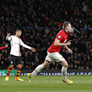 Manchester United's Phil Jones, second right, celebrates after scoring the opening gaol during their Champions League group A soccer match between Manchester United and Shakhtar Donetsk at Old Trafford Stadium, Manchester, England, Tuesday, Dec. 10, 2013
