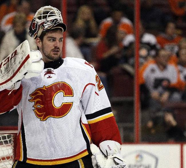 Calgary Flames goalie Reto Barra waits during a break in the second period of an NHL hockey game against the Philadelphia Flyers, Saturday, Feb. 8, 2014, in Philadelphia. The Flyers won 2-1
