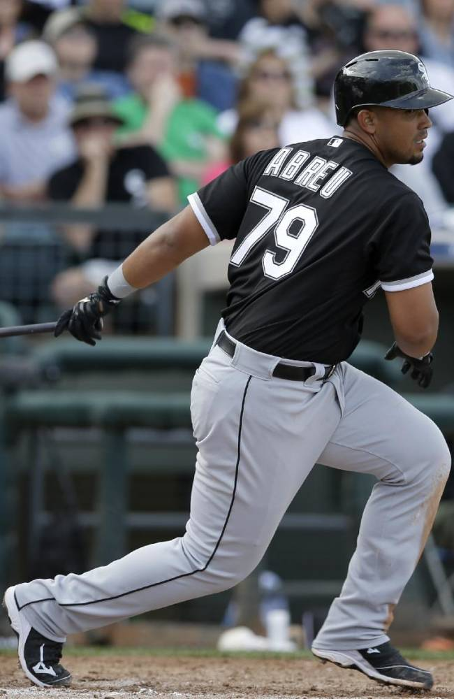 Chicago White Sox's Jose Abreu (79) follows through on a fly-out to right field off a pitch from Texas Rangers' Joakim Soria in the fifth inning of a spring exhibition baseball game on Sunday, March 2, 2014, in Surprise, Ariz