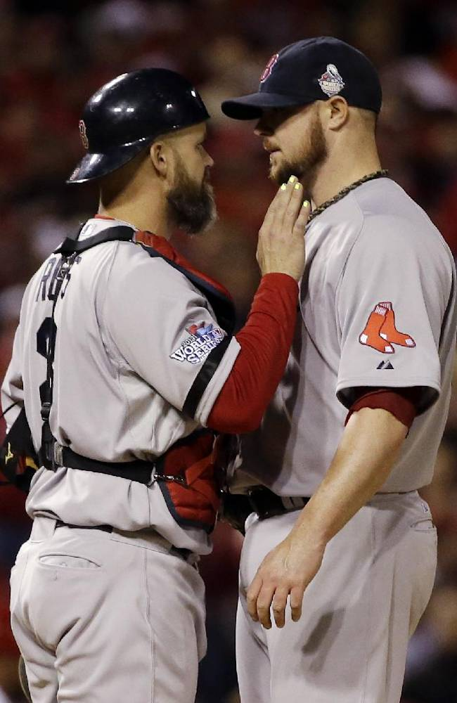 Boston Red Sox catcher David Ross talks to starting pitcher Jon Lester during the eighth inning of Game 5 of baseball's World Series against the St. Louis Cardinals Monday, Oct. 28, 2013, in St. Louis