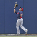 Cleveland Indians left fielder Michael Brantley makes a running catch at the fence on a drive by San Diego Padres' Chase Headley during the second inning of a spring exhibition baseball game on Friday, March 28, 2014, in San Diego The Associated Press