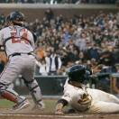 San Francisco Giants' Gregor Blanco, right, scores past Washington Nationals catcher Kurt Suzuki (24) during the second inning of a baseball game in San Francisco, Tuesday, May 21, 2013. (AP Photo/Jeff Chiu)
