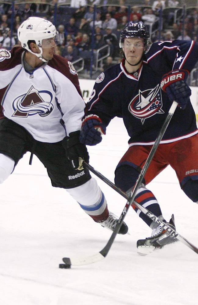 Columbus Blue Jackets' Ryan Johansen (19) collides with Colorado Avalanche's Nate Guenin (5) during the second period of an NHL hockey game, Tuesday, April 1, 2014, in Columbus, Ohio