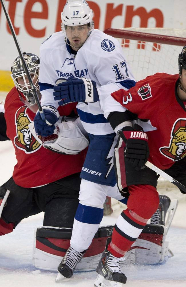 Tampa Bay Lightning center Alex Killorn squeezes between Ottawa Senators goalie Robin Lehner and defenseman Marc Methot during the first period of an NHL hockey game Thursday, March 20, 2014, in Ottawa