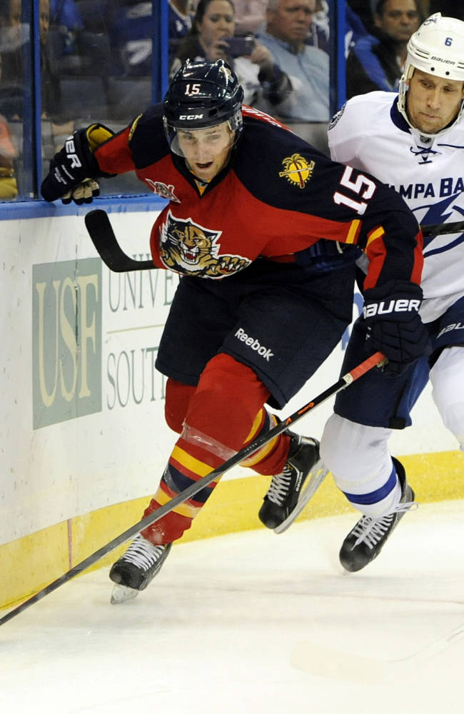 Florida Panthers center Drew Shore, left, battles for the puck against Tampa Bay Lightning defenseman Sami Salo, of Finland, during the first period of a preseason NHL hockey game Saturday, Sept. 21, 2013, in Tampa, Fla