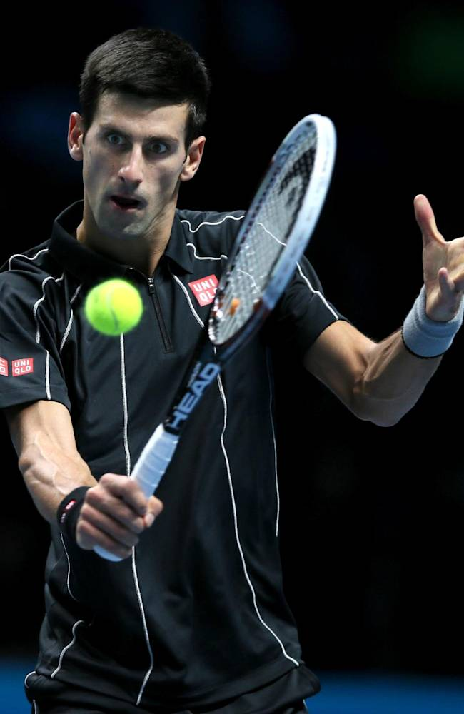 Novak Djokovic of Serbia plays a return to Richard Gasquet of France during their ATP World Tour Finals tennis match at the O2 Arena in London, Saturday, Nov. 9, 2013