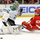Quincey, Helm lift Red Wings over Stars 52 The Associated Press