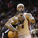 Brooklyn Nets guard Joe Johnson, left, goes up for a shot against Miami Heat forward LeBron James (6) during the second half of an NBA basketball game, Tuesday, April 8, 2014 in Miami. Johnson scored 19 points and James had 29 points as the Nets defeated